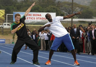 Britain039s Prince Harry L and Olympic gold medallist Usain Bolt pose