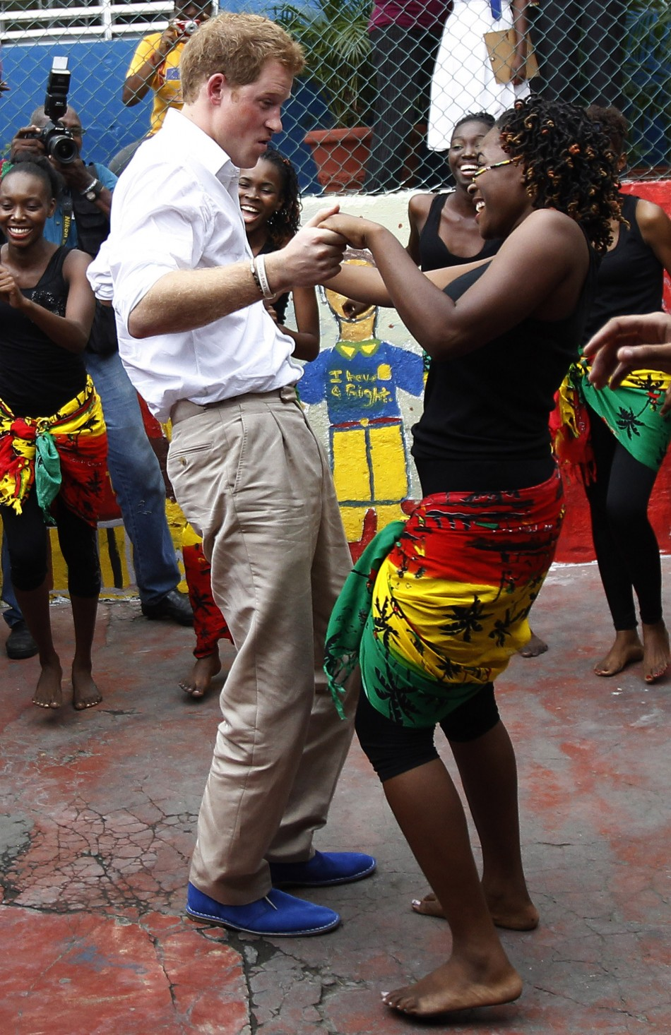 Britains Prince Harry dances with Chantol Dormer