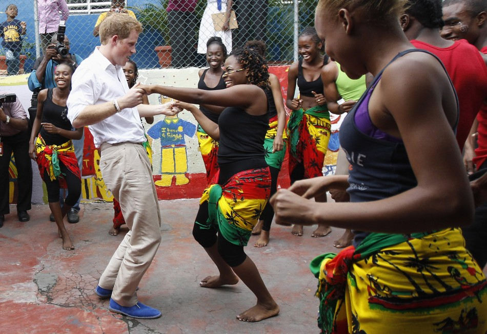 Britain039s Prince Harry dances with Chantol Dormer