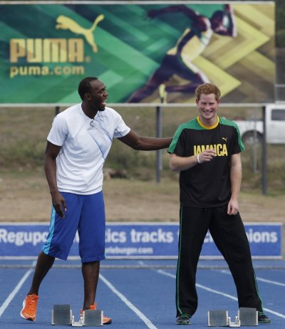 Britain039s Prince Harry R and Olympic gold medallist Usain Bolt talk at the starting blocks