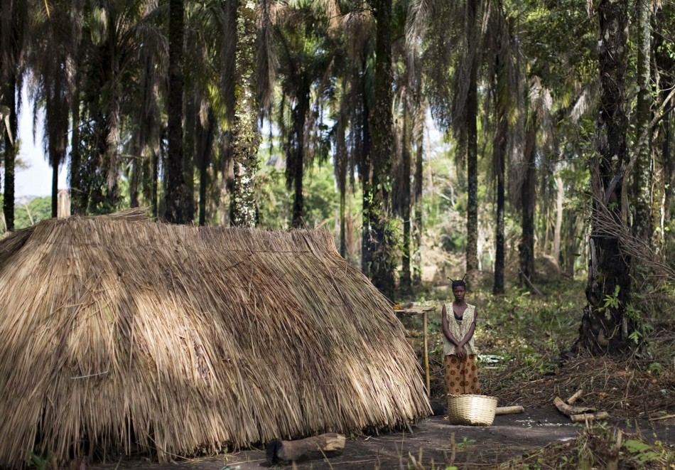 A woman who fled attacks by Ugandan LRA rebels stands outside a makeshift shelter at Ngalima in northeastern Congo
