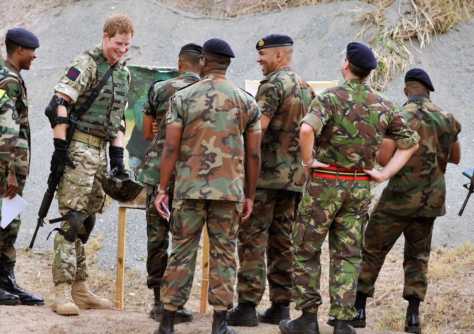 Britain039s Prince Harry 2nd L talks to members of the Jamaican Defence Force