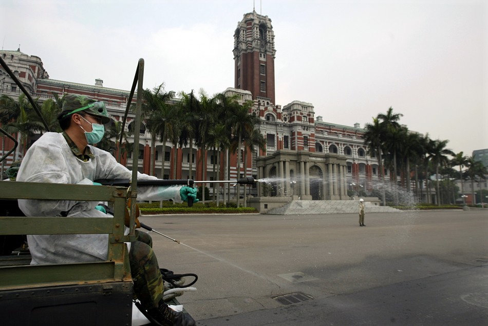 Taiwanese soldier sprays bleach outside presidential palace in Taipei during Sars outbreak