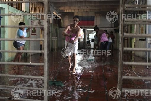 Inmates wash the floor in Cartagena's Women's District Jail in preparation for an event marking International Women's Day