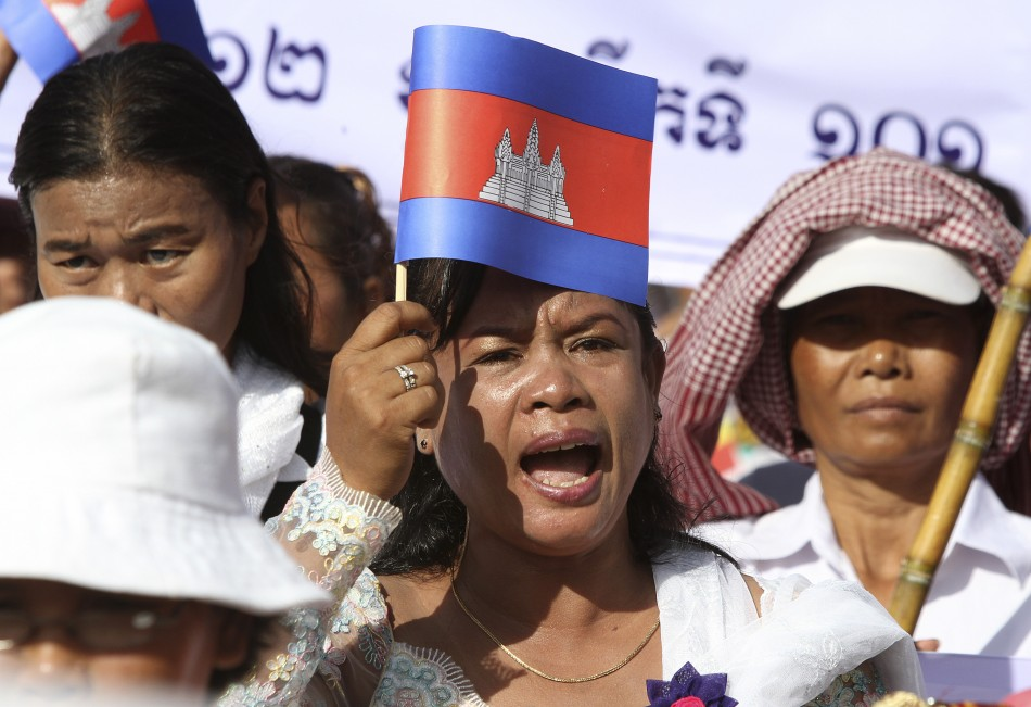 A Cambodian woman shouts as she marches on a street to celebrate International Women's Day in central Phnom Penh
