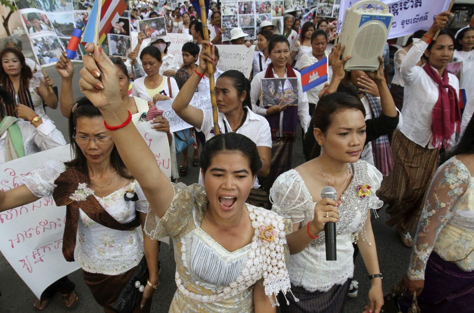Cambodian woman shouts slogans while marching to mark International Women's Day in central Phnom Penh