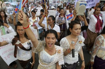 Cambodian woman shouts slogans while marching to mark International Womens Day in central Phnom Penh