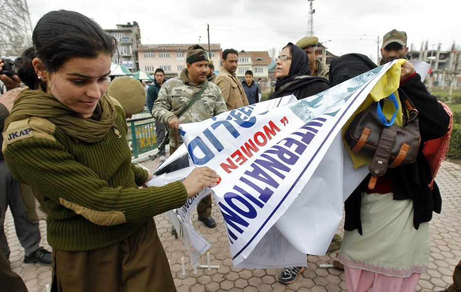 Policewoman snatches banner from members of Kashmiri women's separatist group in Srinagar