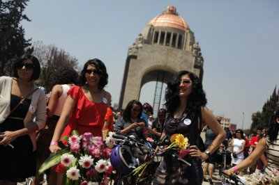 Women stand next to their bicycles before a ride to celebrate International Womens Day in downtown Mexico City