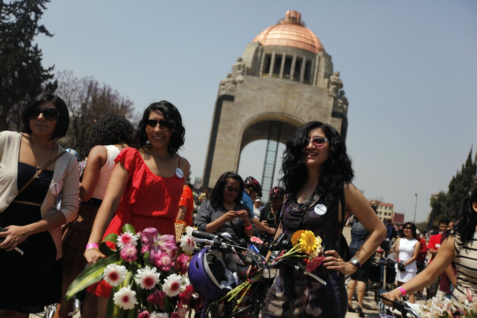 Women stand next to their bicycles before a ride to celebrate International Women's Day in downtown Mexico City