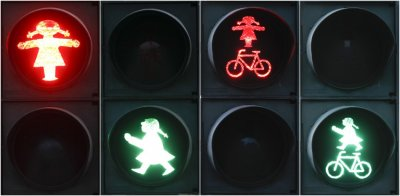 A combination of four pictures show red and green crossing signals for pedestrian and cyclists featuring a woman in the east German town of Fuerstenwalde