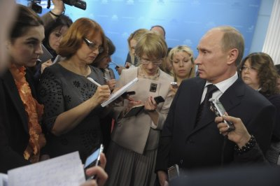 Russian PM Putin congratulates female journalists from the government pool group on the upcoming International Womens Day in Moscow