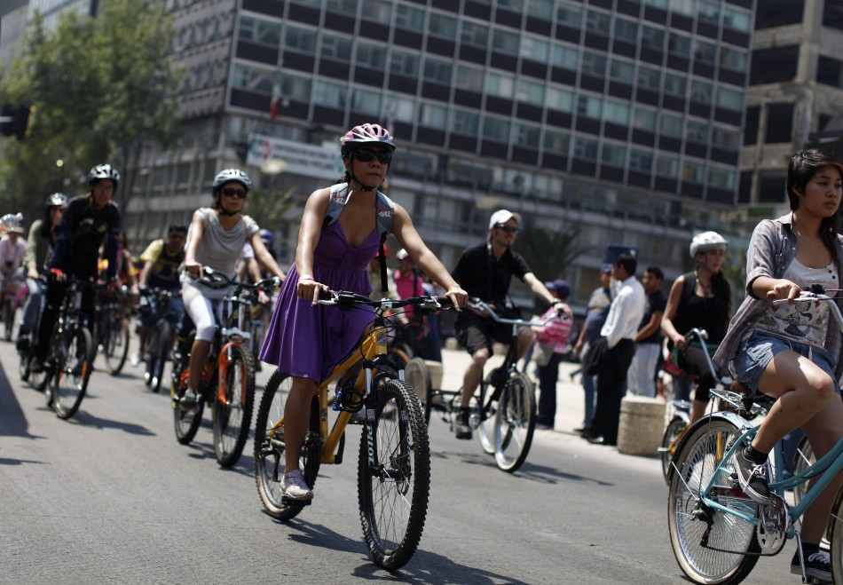 Women ride bicycles during an event to celebrate International Women's Day in downtown Mexico City