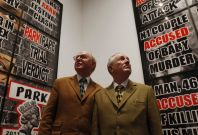 "Artists Gilbert & George pose in front of their new exhibition ""London Pictures"" at a White Cube gallery in London"