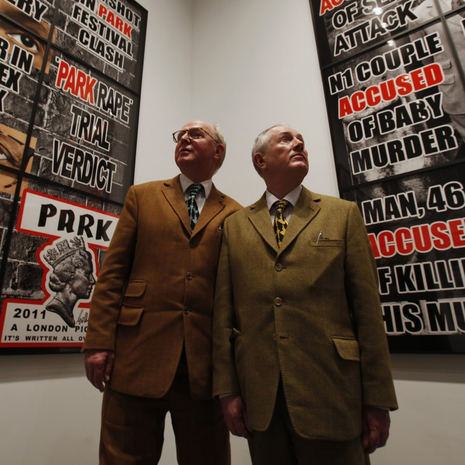 Artists Gilbert  George pose in front of their new exhibition quotLondon Picturesquot at a White Cube gallery in London