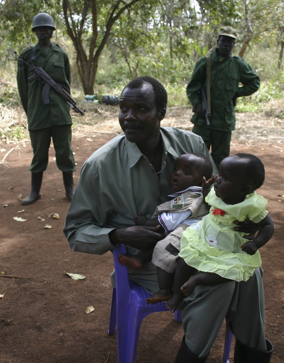 LRA leader Kony poses with daughter and son at peace negotiations in Ri-Kwangba