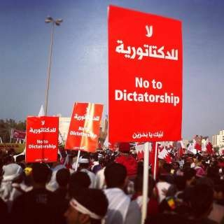 Thousands of protesters marched with banners that called for more democracy and social justice