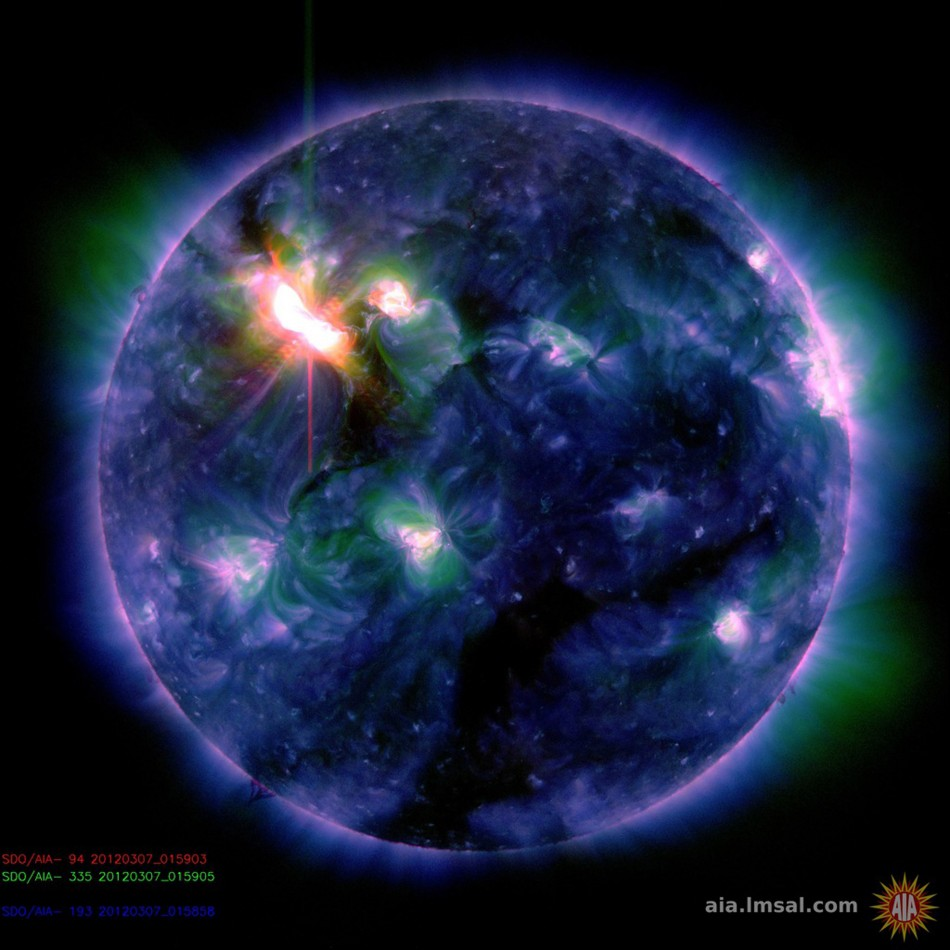 A multi-colored NASA handout photo of the Sun
