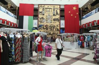 A shopper walks at the Dragonmart mall in Dubai, February 26, 2012.