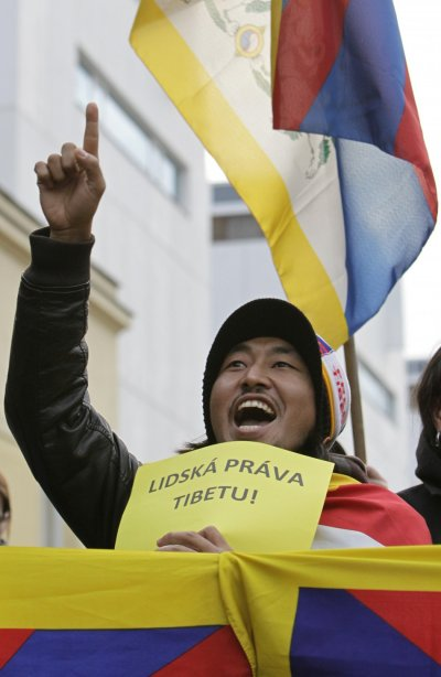 A Tibetan demonstrator shouts slogans during a protest rally in front of the Chinese embassy