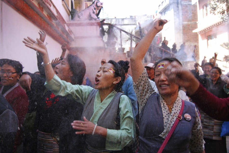 Tibetans take part in a ritual at a function to mark the Tibetan Uprising Day