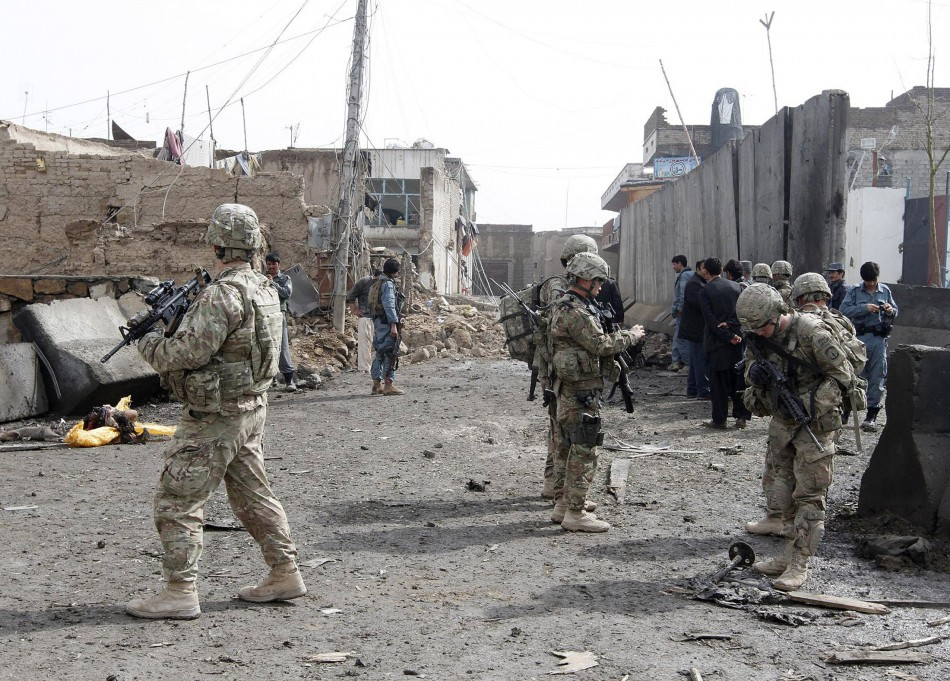 U.S. soldiers and Afghan policemen keep watch n Kandahar in February