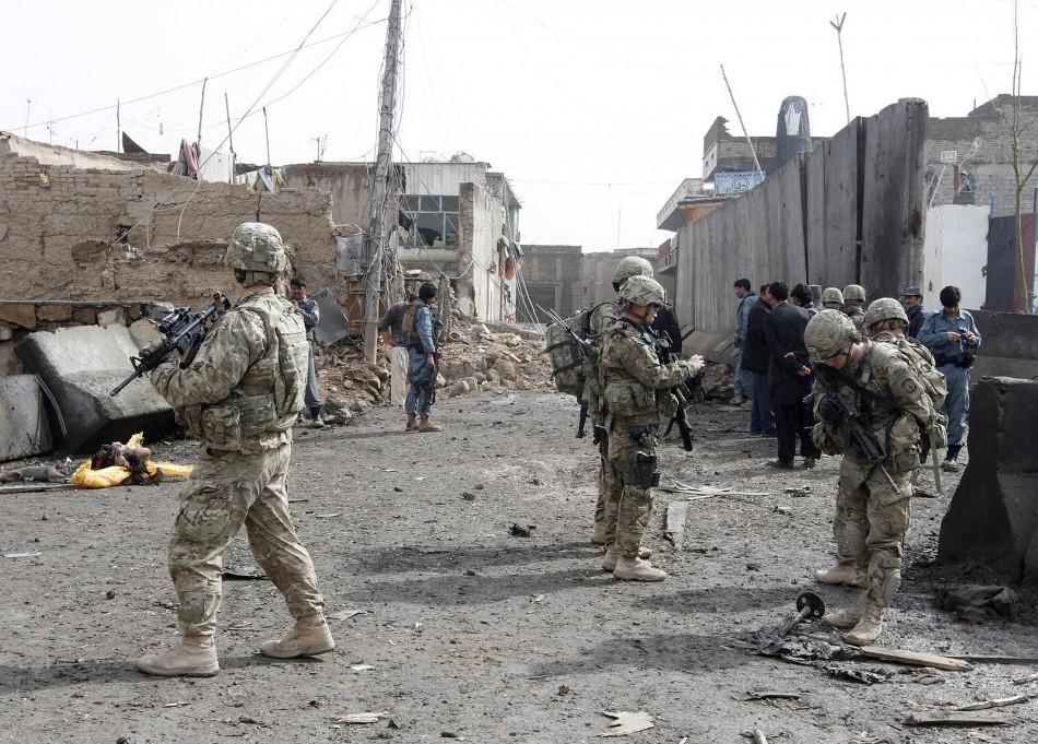 U.S. soldiers and Afghan policemen keep watch n Kandahar in February
