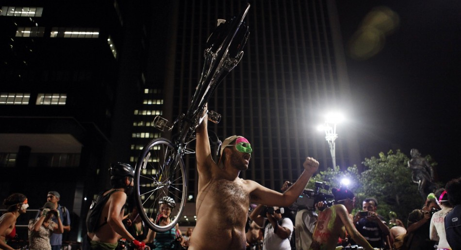 Naked cyclist holds his bicycle up during the quotWorld Naked Bike Ridequot on Sao Paulo039s Paulista Avenue