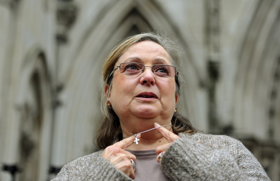 Britain's Eweida shows off her cross on a chain as she arrives at the High Court in London in 2010