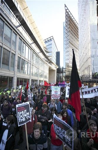 Students protesting against tuition fee increases march towards the business district in the City of London last year