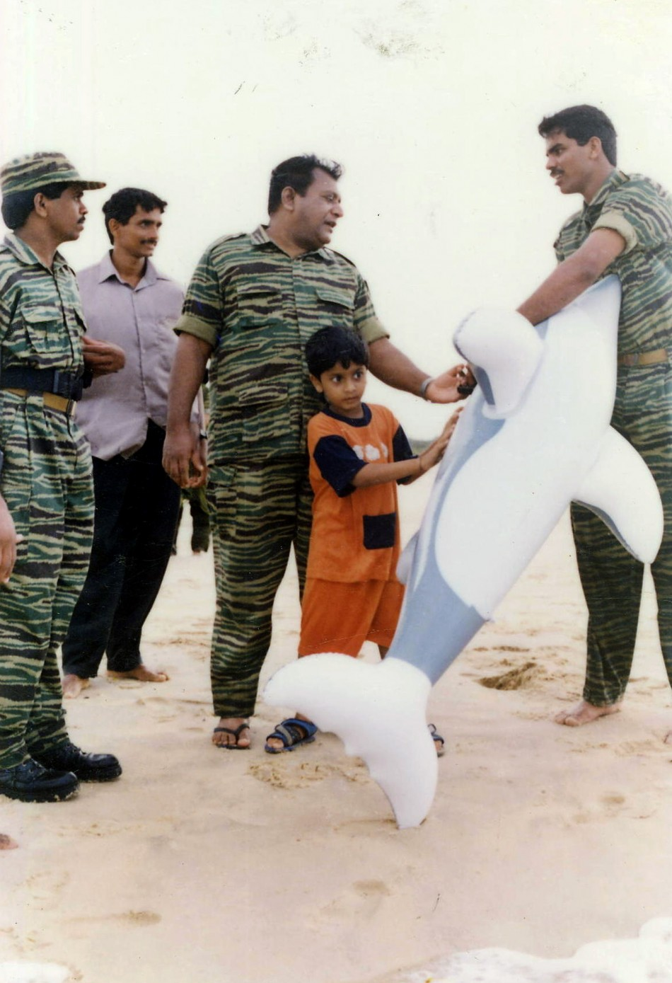 Undated picture given by Sri Lankan Ministry of Defence shows LTTE leader Prabhakaran playing with his son