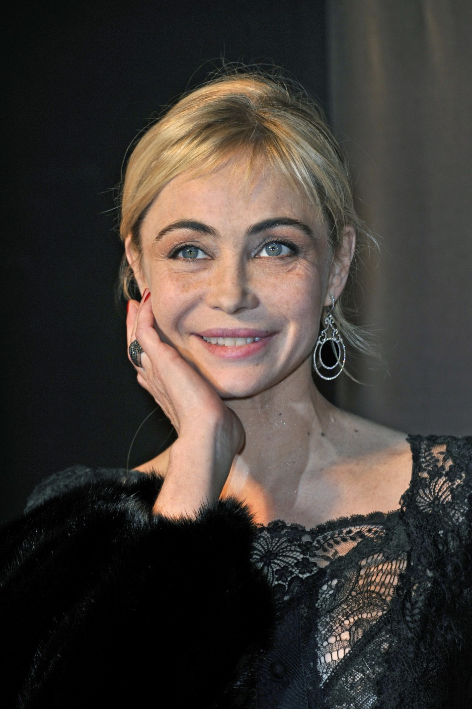 Beart poses for photographers as she arrives at the 36th Cesar Awards ceremony in Paris in 2011