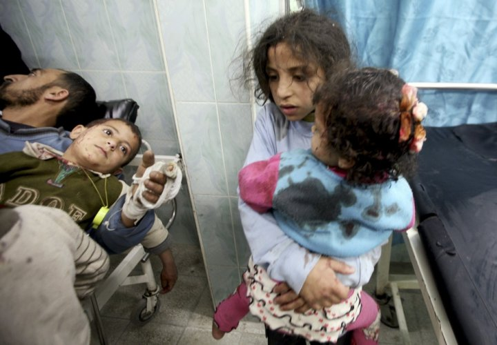 Wounded Palestinian children are seen in a hospital in the northern Gaza Strip, after an Israeli air strike
