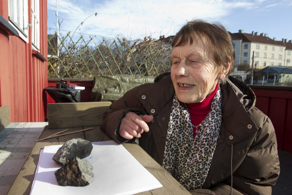 Anne Margrethe Thomassen looks at the meteorite, in central Oslo