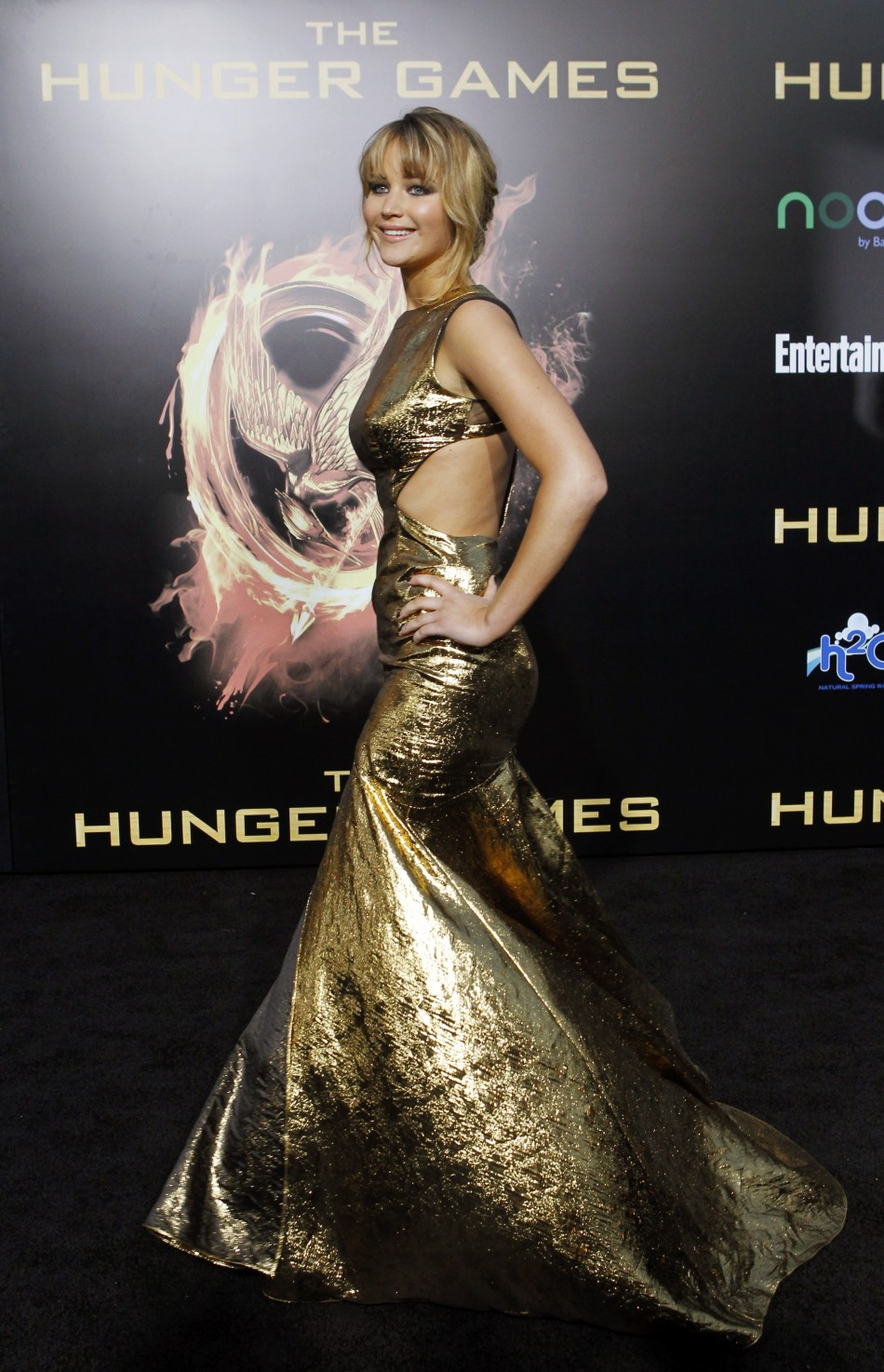 "Cast member Jennifer Lawrence poses at the premiere of ""The Hunger Games"" in Los Angeles"