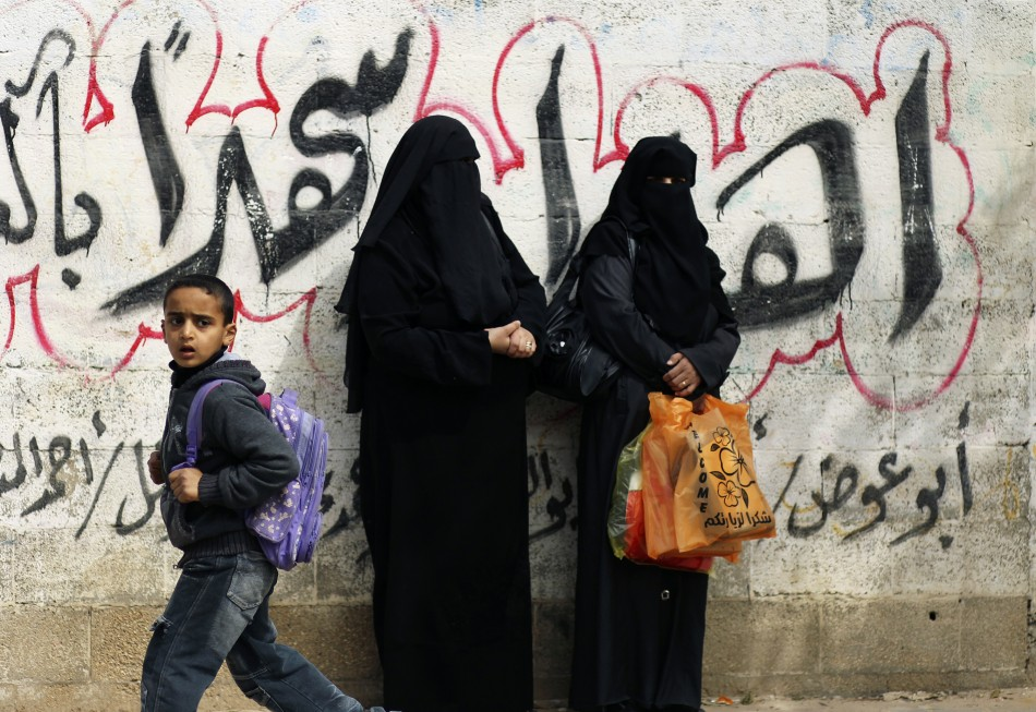 Palestinian women watch funeral of Islamic Jihad militant Mohammed Daher in Gaza City