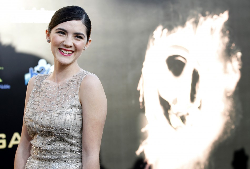 "Cast member Isabelle Fuhrman poses at the premiere of ""The Hunger Games"" at Nokia theatre in Los Angeles"