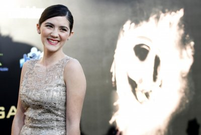 Cast member Isabelle Fuhrman poses at the premiere of quotThe Hunger Gamesquot at Nokia theatre in Los Angeles