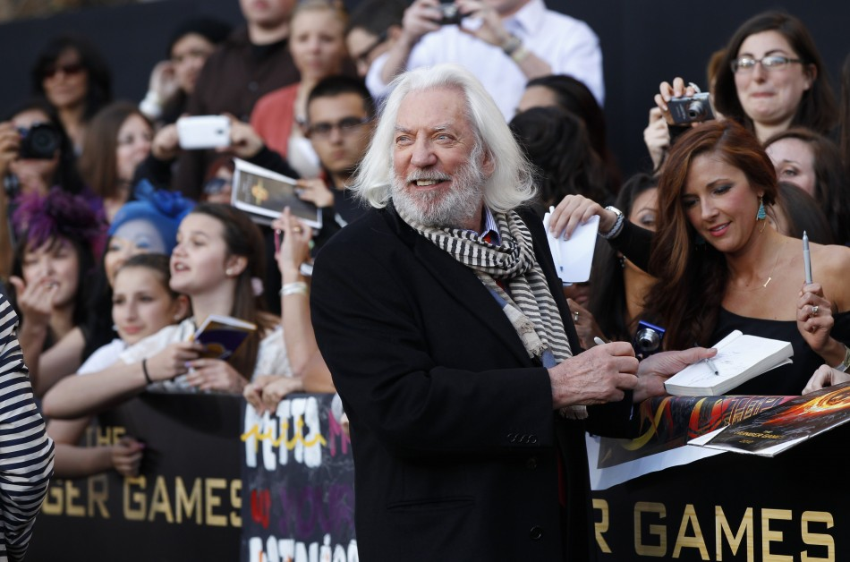 "Cast member Donald Sutherland signs autographs at the premiere of ""The Hunger Games"" at Nokia theatre in Los Angeles"