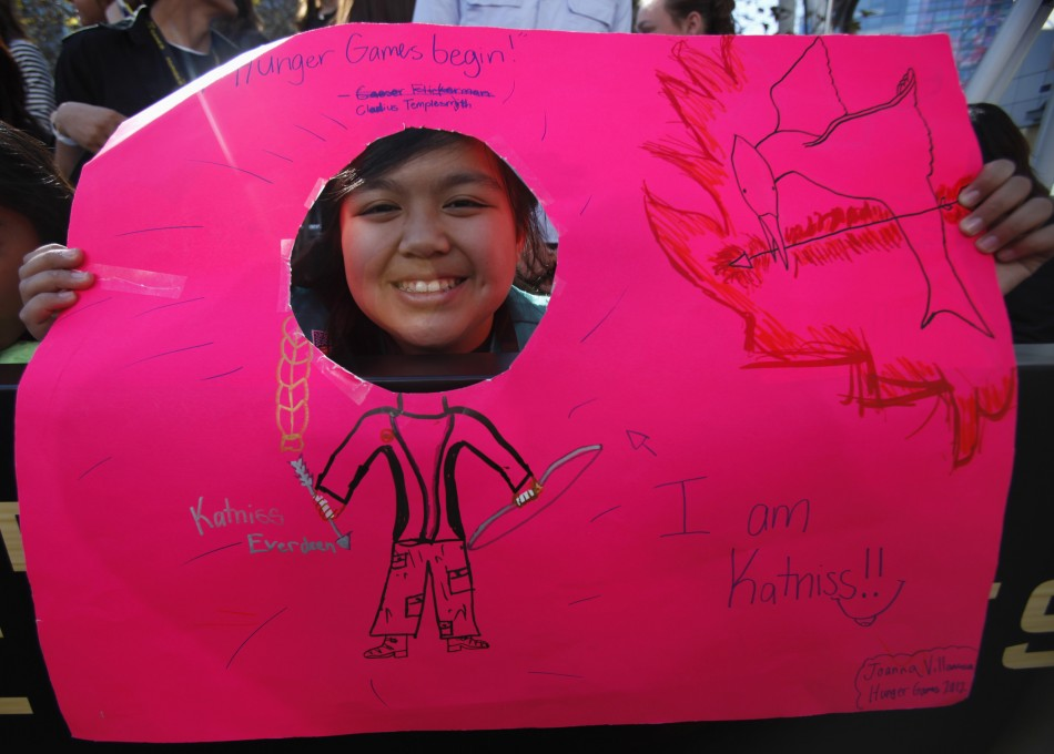 Villanueva holds a sign as she waits at the premiere of quotThe Hunger Gamesquot at Nokia theatre in Los Angeles