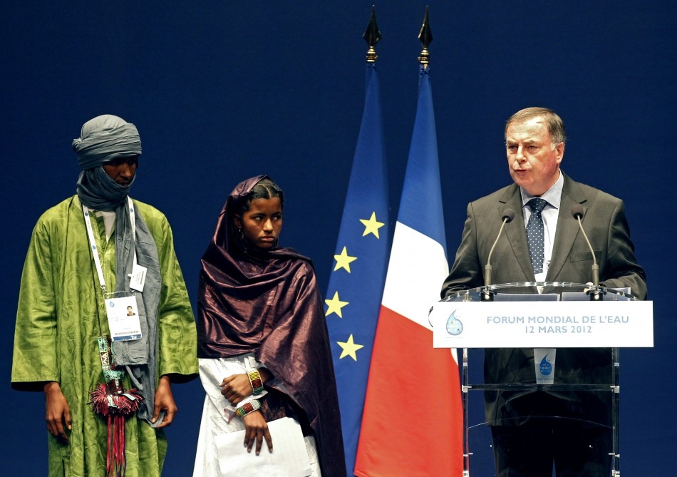 World Water Council president Fauchon delivers a speech next to Malian students at the 6th World Water Forum in Marseille