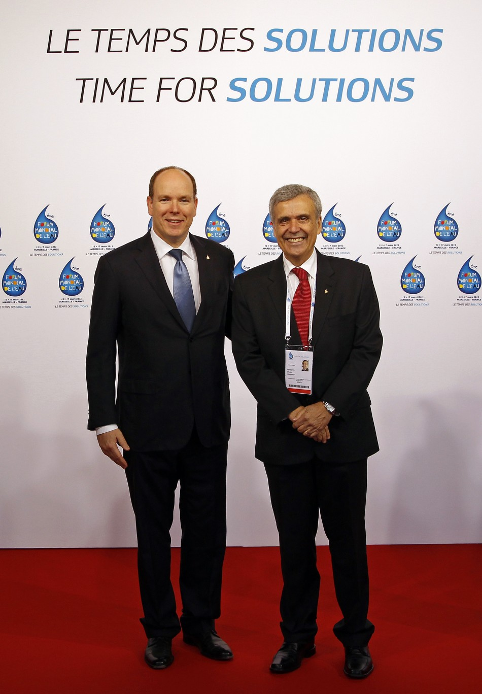 Prince Albert of Monaco poses with President of the International Forum Committee Braga as they arrive at the 6th World Water Forum in Marseille