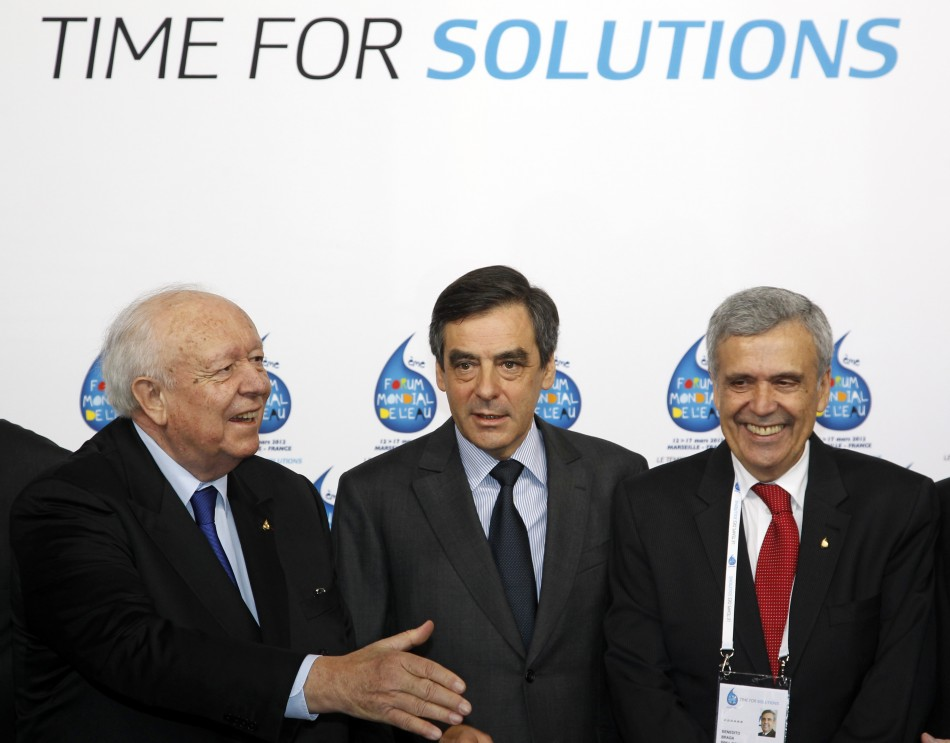 France's Prime Minister Fillon surrounded by Marseille's mayor Gaudin and President of the International Forum Committee Benedito Braga arrive at the 6th World Water Forum in Marseille