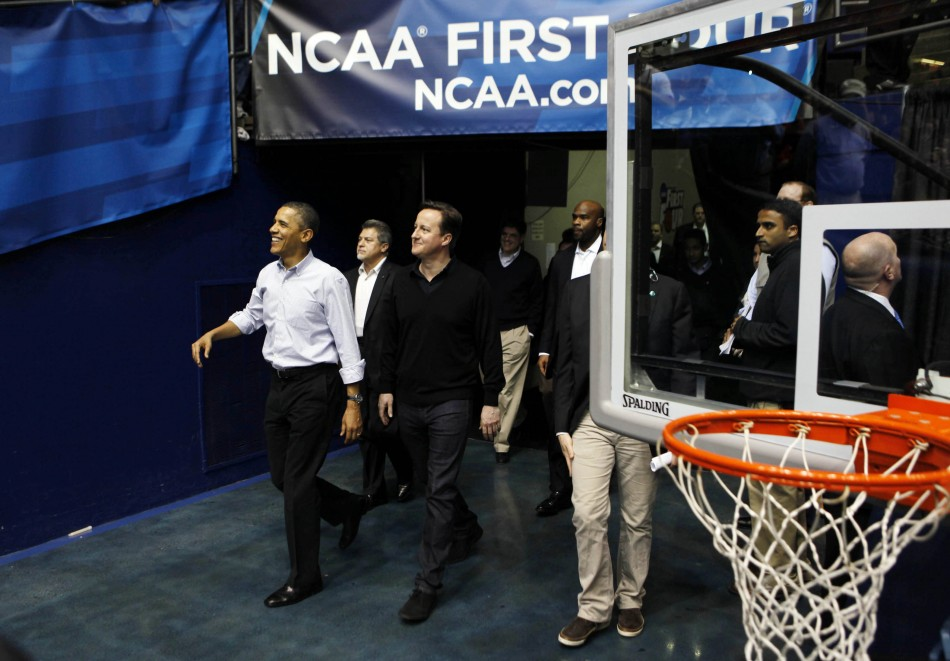 U.S. President Obama and British Prime Minister Cameron arrive at NCAA basketball tournamnet game in Ohio