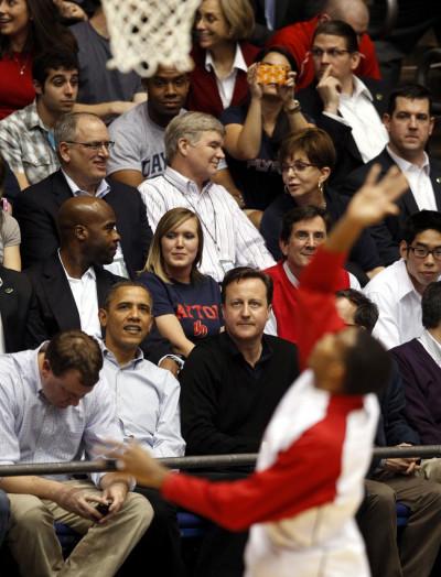 U.S. President Barack Obama sits next to British Prime Minister David Cameron