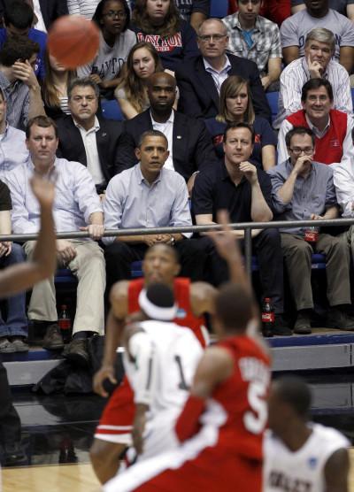 U.S. President Barack Obama and British Prime Minister David Cameron attend a NCAA tournament