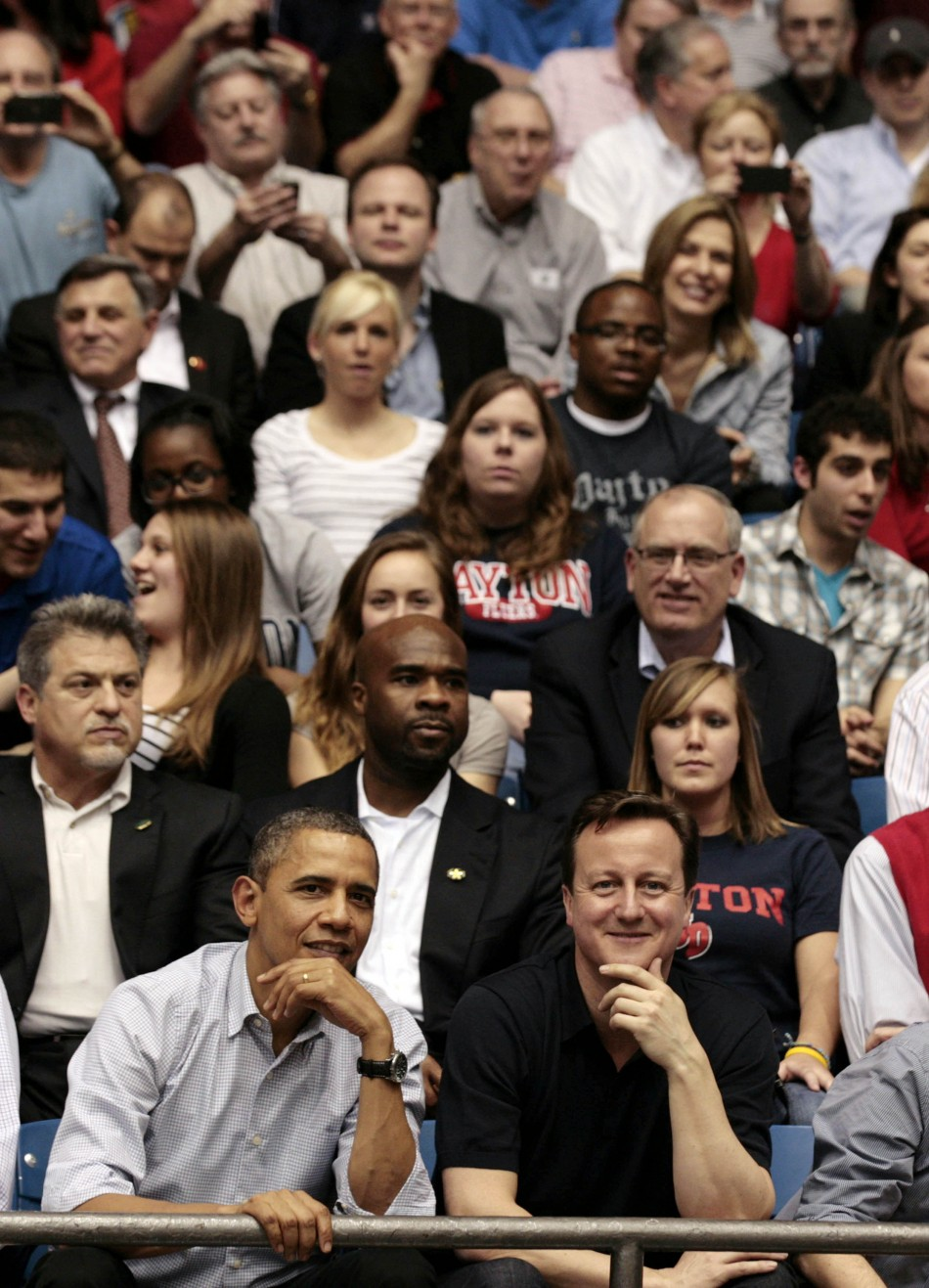 U.S. President Obama and British Prime Minister Cameron in crowd during NCAA basketball tournamnet