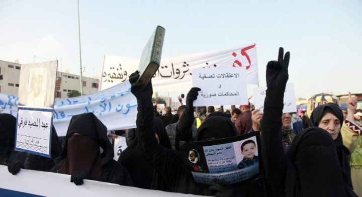 """Veiled women take part in a demonstration called by the """"February 20 Movement"""" demonstration organized by the February 20 Movement"""