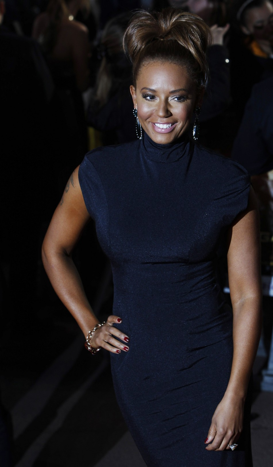 """Singer and former Spice Girl Mel B poses for photographers as she arrives for the European premiere of """"The Hunger Games"""" at the O2 Arena in London"""