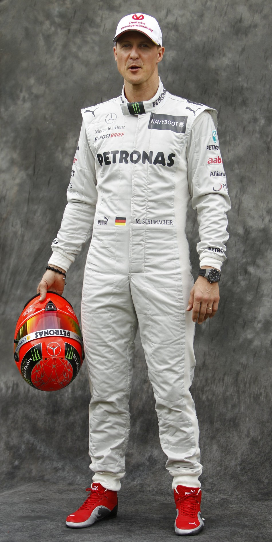Mercedes Formula One driver Schumacher poses prior to the Australian F1 Grand Prix at the Albert Park circuit in Melbourne